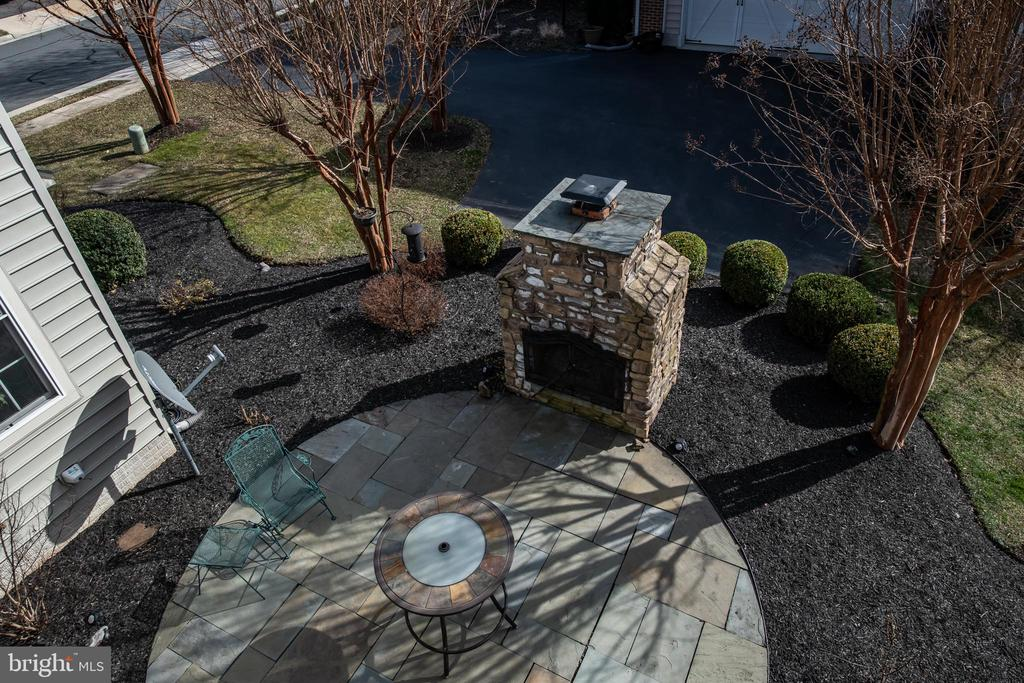 View from deck to patio. - 21883 KNOB HILL PL, ASHBURN