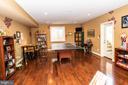 Game room with wood floors - 21883 KNOB HILL PL, ASHBURN