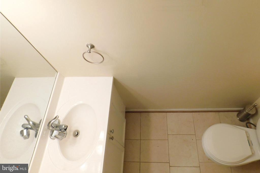 Main Level Powder Room with Tile Floor - 2047 CHADDS FORD DR, RESTON