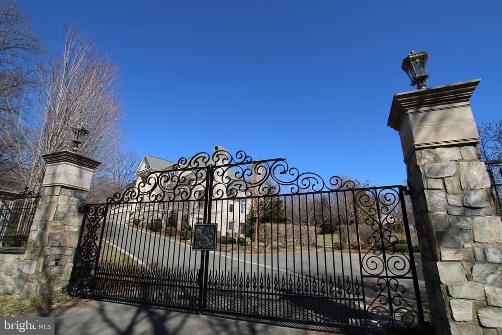 Custom made iron gate opens to a unique estate - 529 SPRINGVALE RD, GREAT FALLS