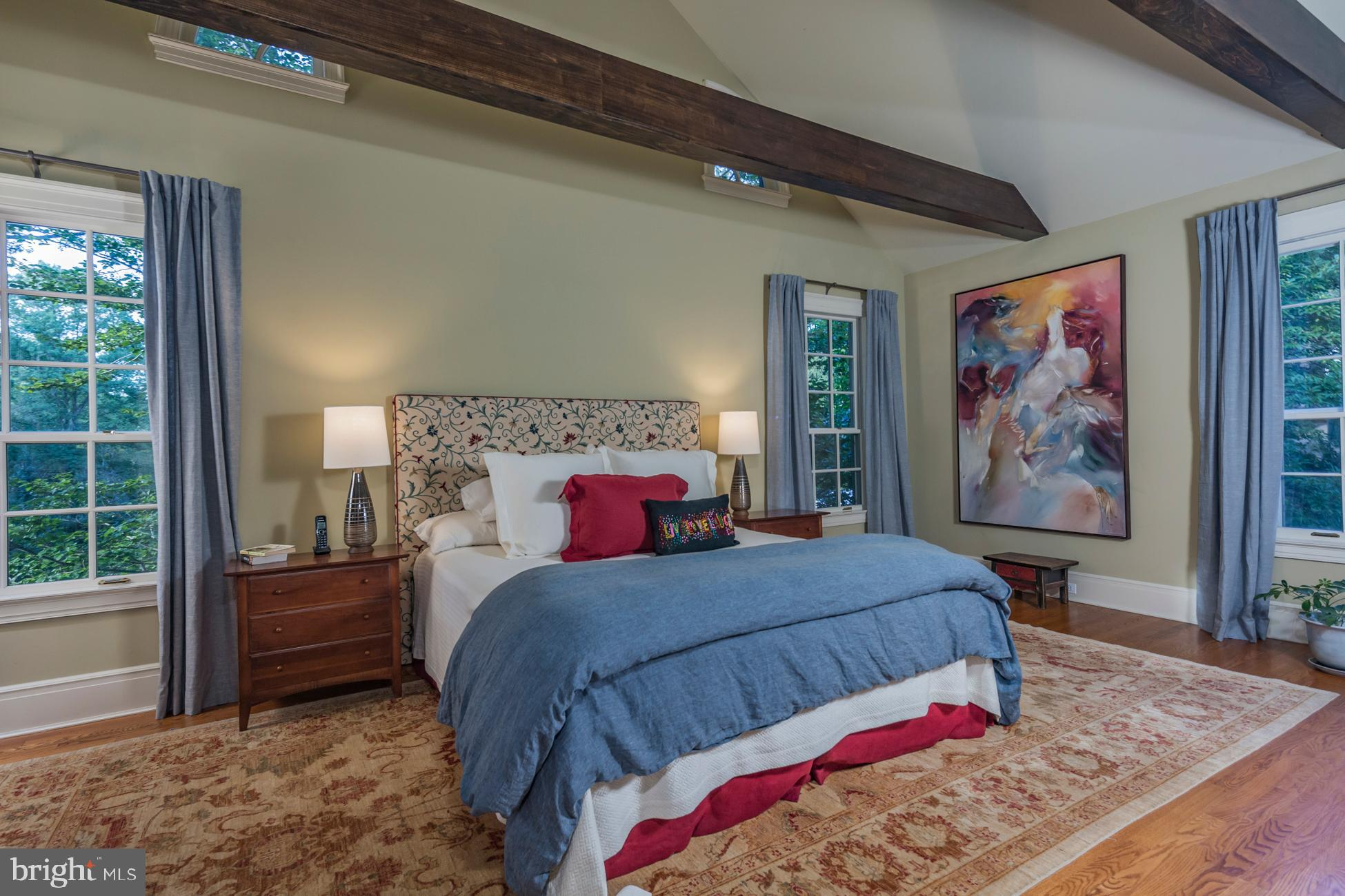 Tranquil master bedroom with vaulted ceiling.