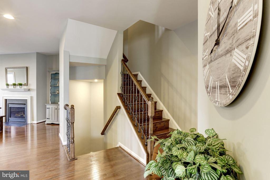 Main Level Stairway w/ Hardwoods & Iron Balusters - 22754 BALDUCK TER, ASHBURN