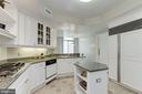 Kitchen opens to Breakfast Room Area - 5630 WISCONSIN AVE #807, CHEVY CHASE
