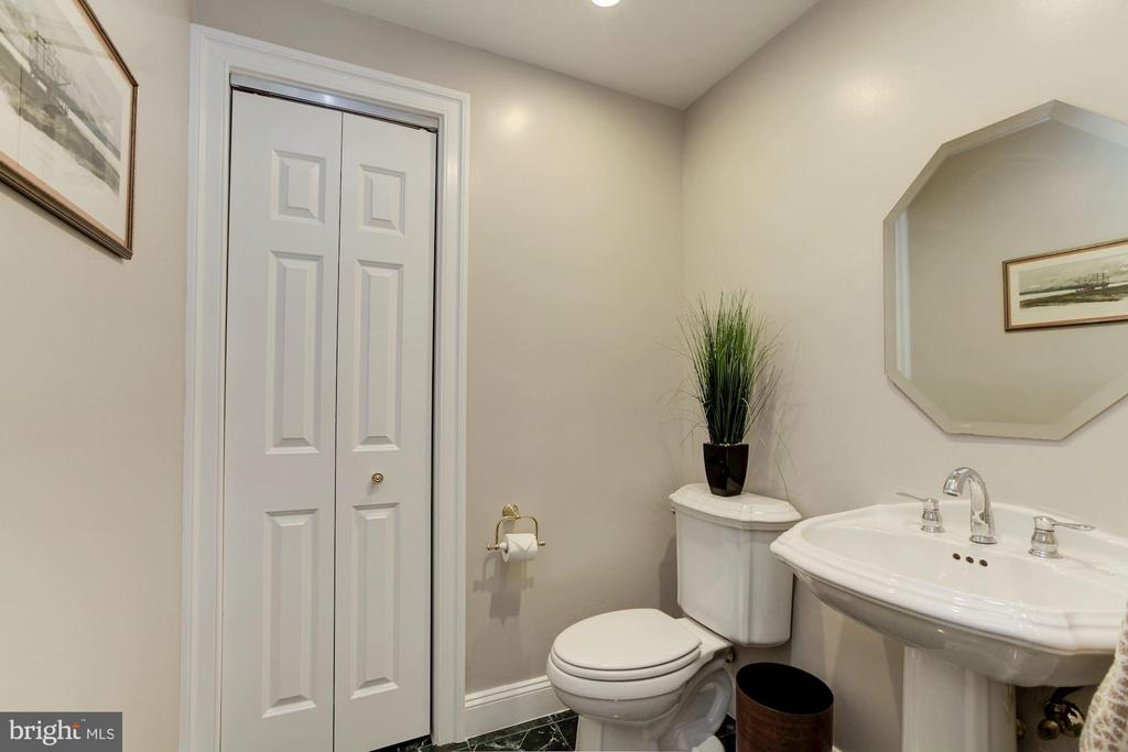 Powder Room with marble floors - 5630 WISCONSIN AVE #807, CHEVY CHASE