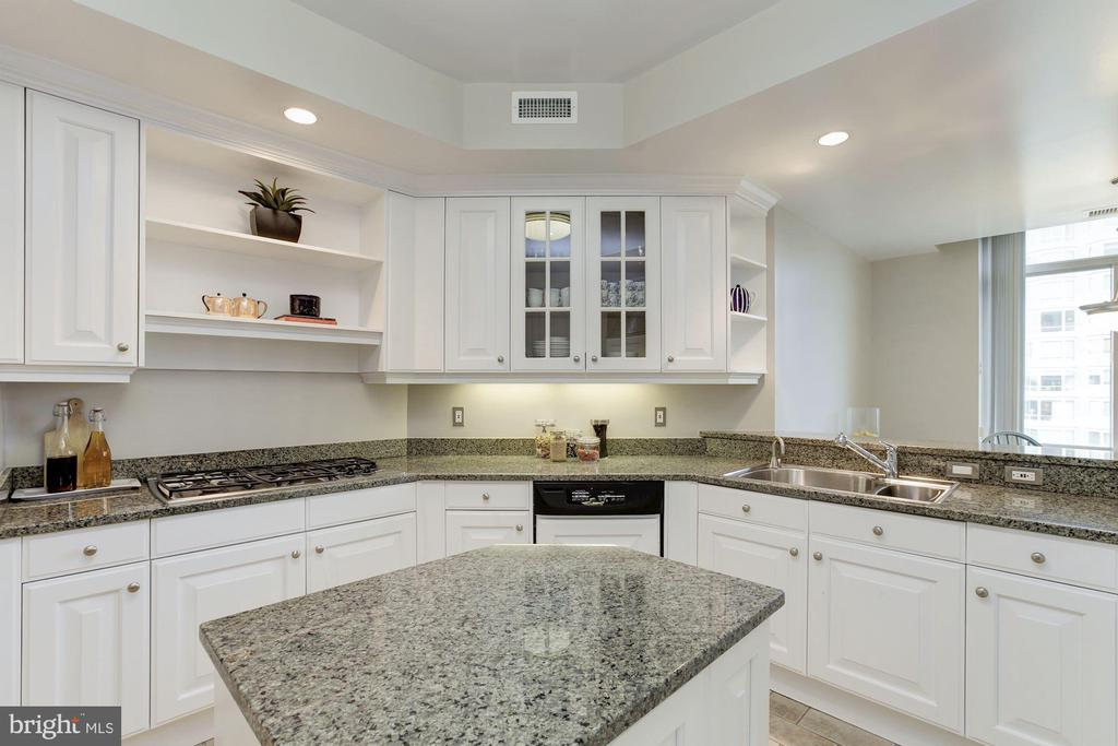 Kitchen with island and glass front cabinetry - 5630 WISCONSIN AVE #807, CHEVY CHASE