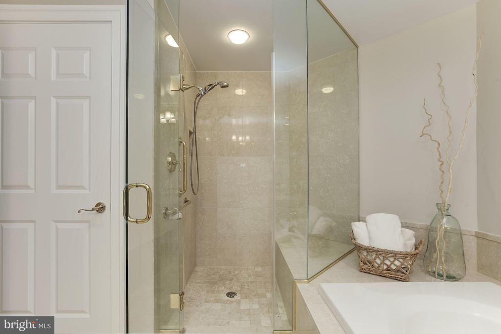 Separate, seamless glass shower with marble tile - 5630 WISCONSIN AVE #807, CHEVY CHASE