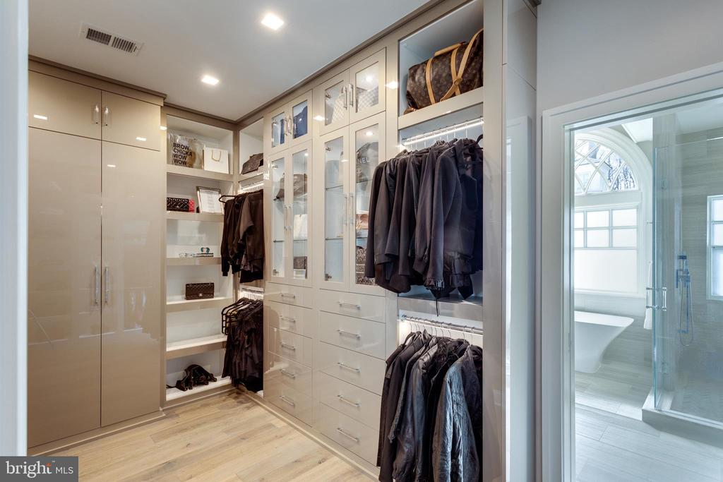 Mstr closet 1 is tricked out for a clothing lover - 7301 DULANY DR, MCLEAN