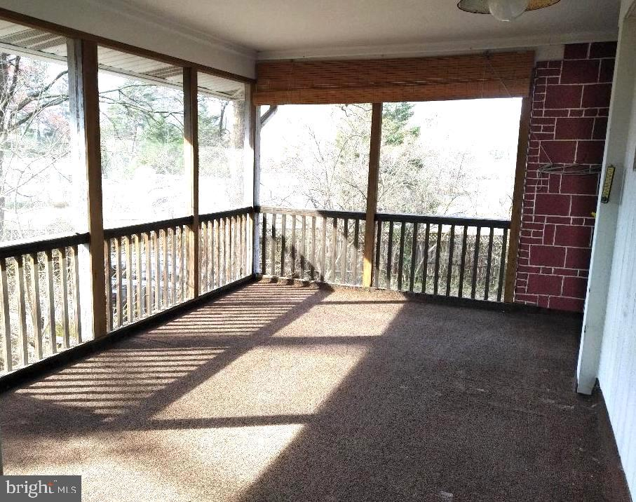 View of Screened in porch from Family room - 7604 GLENNON DR, BETHESDA