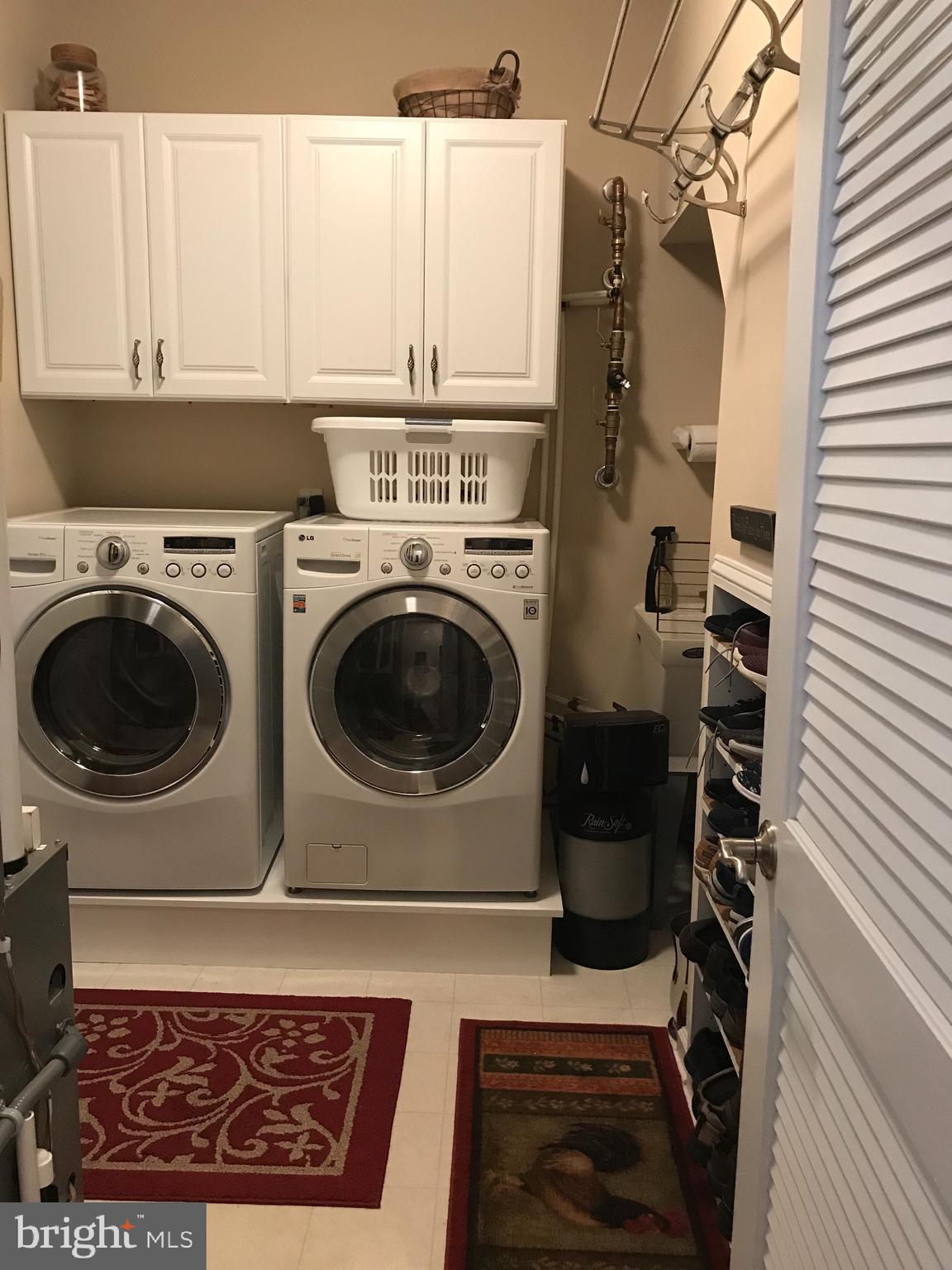 Laundry with built in show cubby and hanging rack!