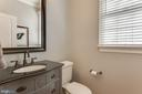 Main level powder room in between - 121 SINEGAR PL, STERLING