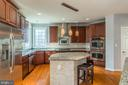 Gourmet kitchen with stainless steel appliances - 18487 KERILL RD, TRIANGLE