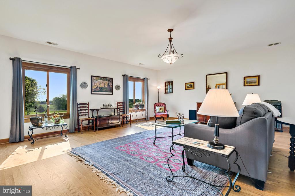 Living room with hardwoods& picture window views - 38581 DAYMONT LN, WATERFORD