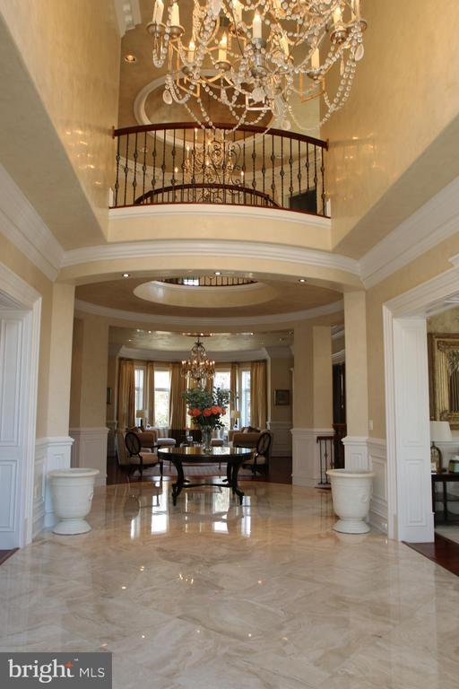 Marble foyer with elegant chandelier and overlook - 529 SPRINGVALE RD, GREAT FALLS