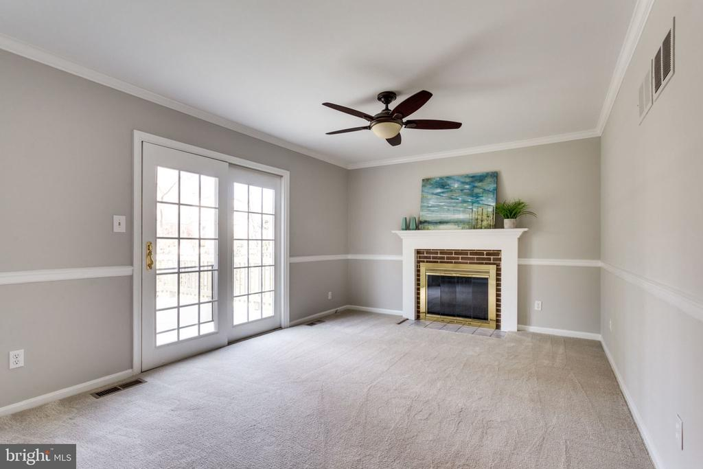 Family Room ft. cozy fireplace and opens to deck. - 4708 FEDERAL CT, ANNANDALE
