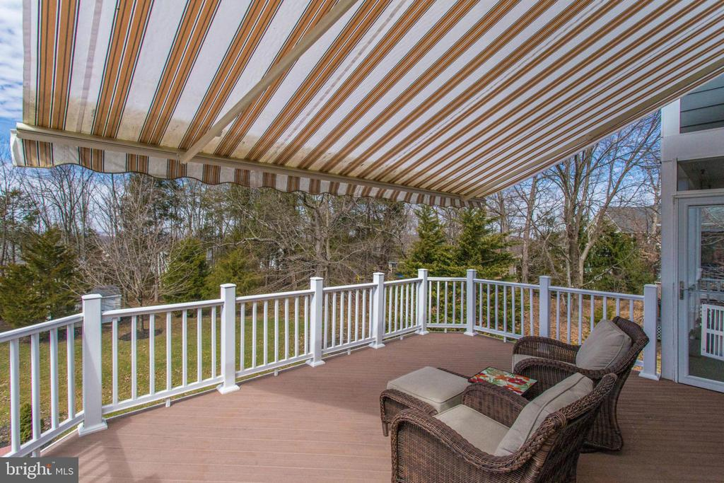 Deck over looks beautiful tree lined backyard. - 42760 RIDGEWAY DR, BROADLANDS