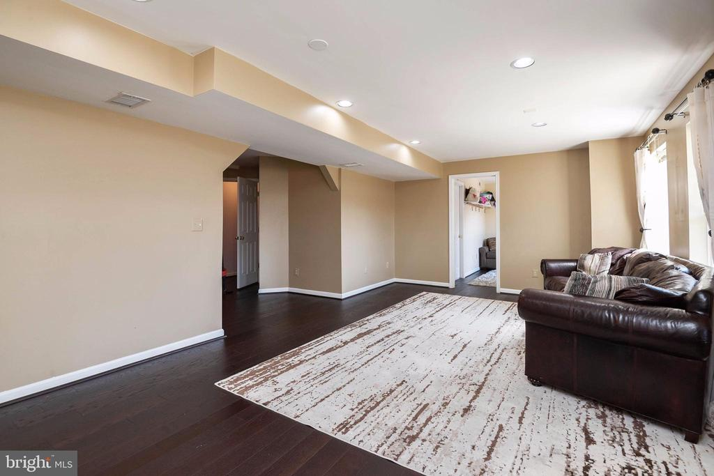 Engineered flooring on lower level with walk out. - 8153 SILVERBERRY WAY, VIENNA