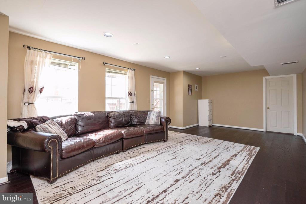 Lower level family room for TV or exercise. - 8153 SILVERBERRY WAY, VIENNA