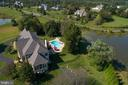 Drone Exterior Side View Of Home & Pond - 41244 GRENATA PRESERVE PL, LEESBURG