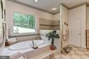 Master bath shower has 8 body sprayers - 6910 SCENIC POINTE PL, MANASSAS