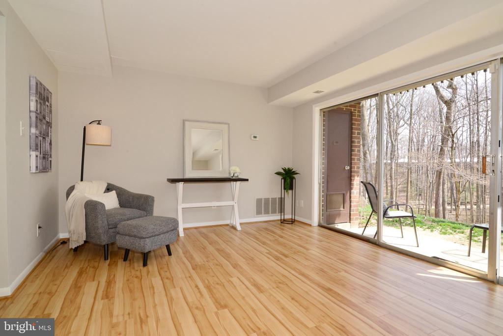 Living Room with Sliding Glass Doors to Patio. - 11623 VANTAGE HILL RD #1A, RESTON