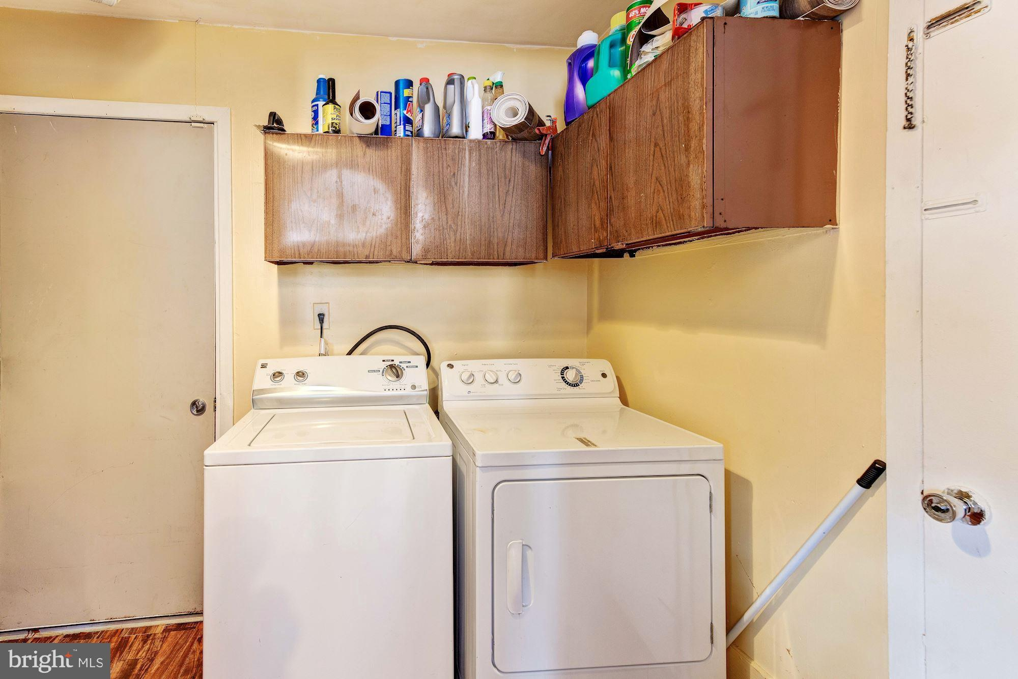 Utility room with washer, dryer and new wood floor