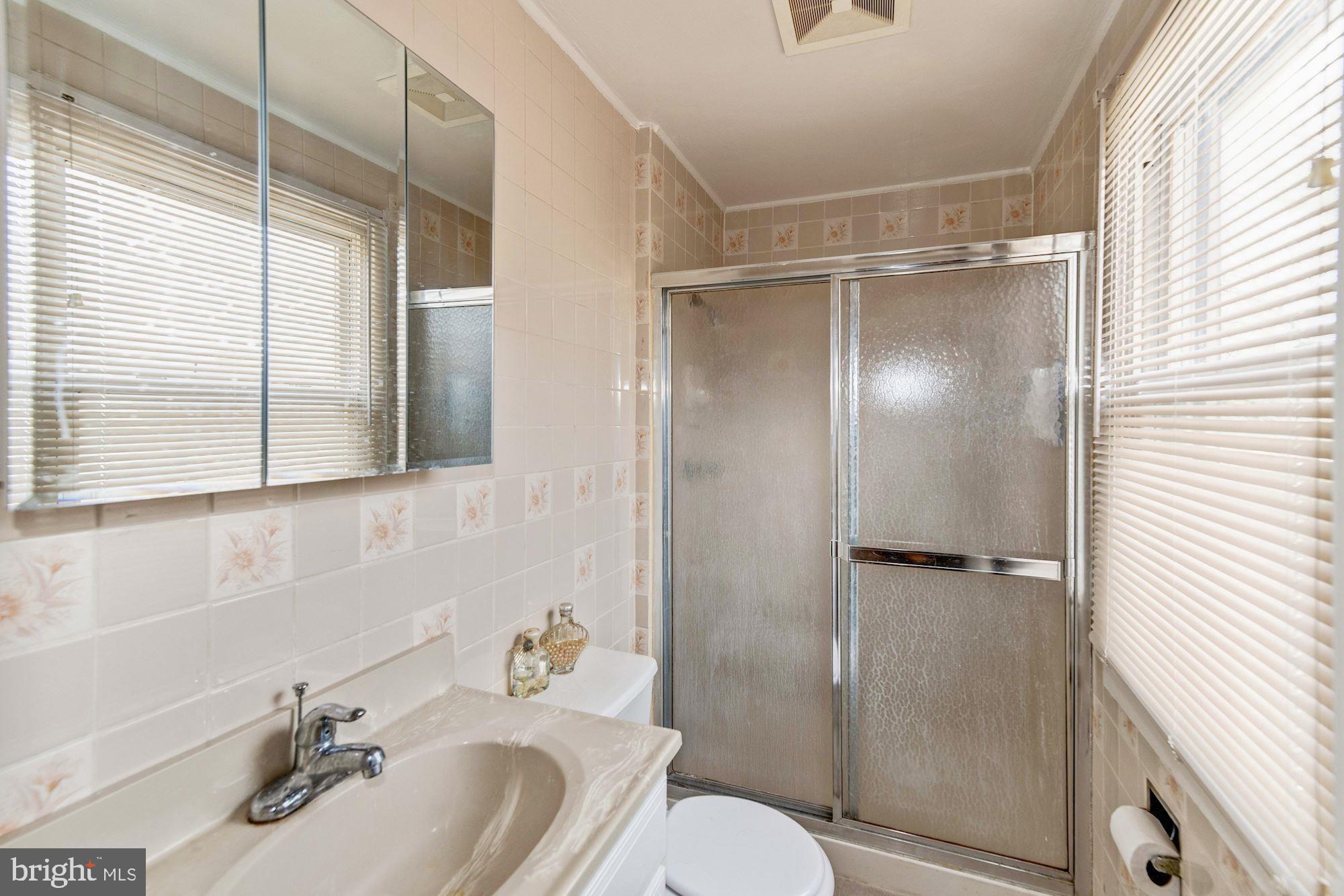 Master bath w/ stall shower, ceramic floors/wall