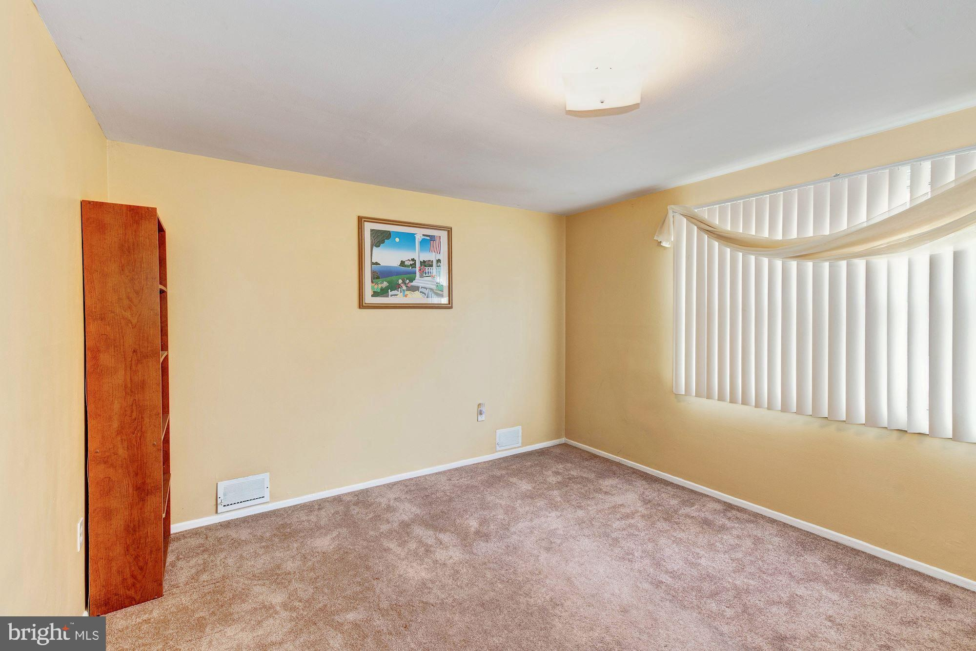 3rd bedroom with carpet