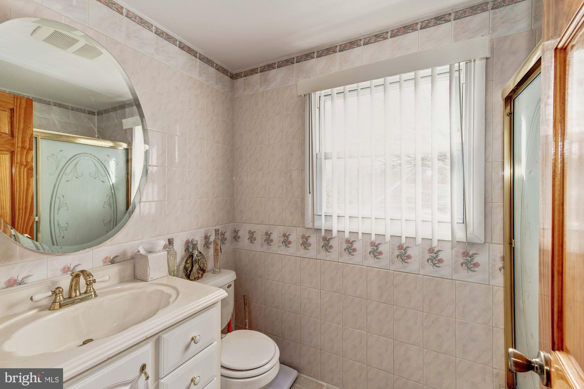 2nd full bath with ceramic floors and walls
