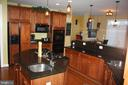 Kitchen with custom cabinetry - 43122 ROCKY RIDGE CT, LEESBURG