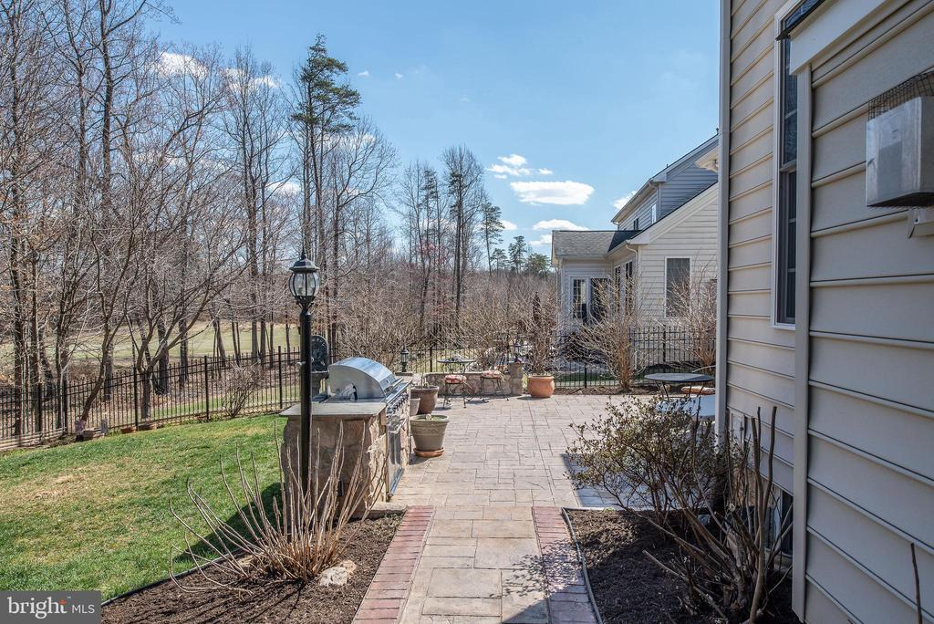 Stamped concrete walkway leading to large patio. - 3 GRISTMILL DR, STAFFORD