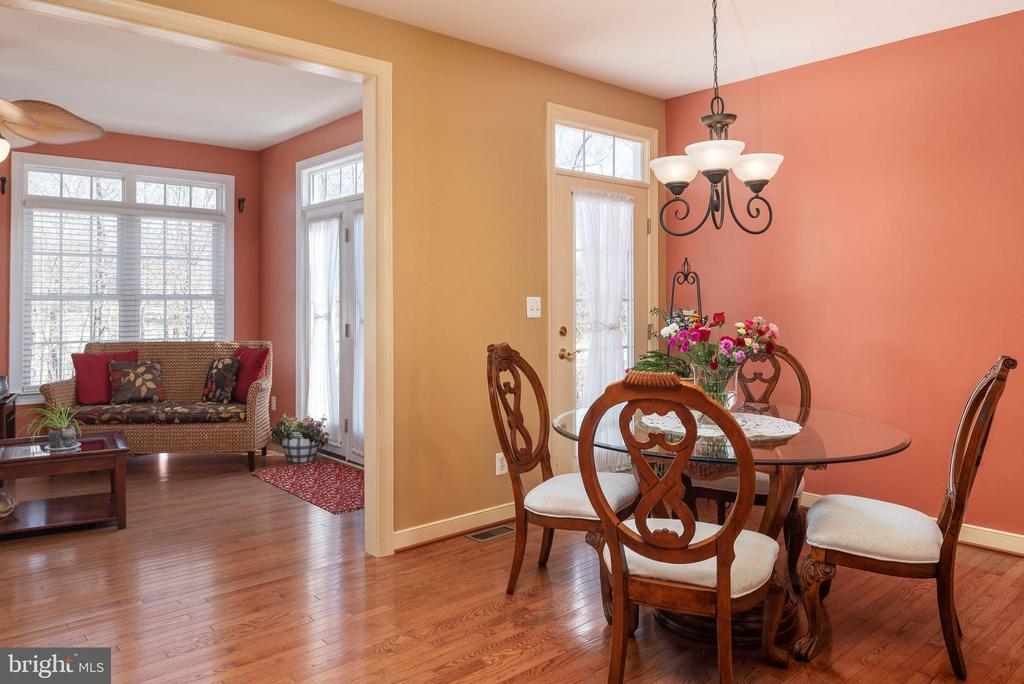 Sunroom and kitchen have doors to backyard. - 3 GRISTMILL DR, STAFFORD