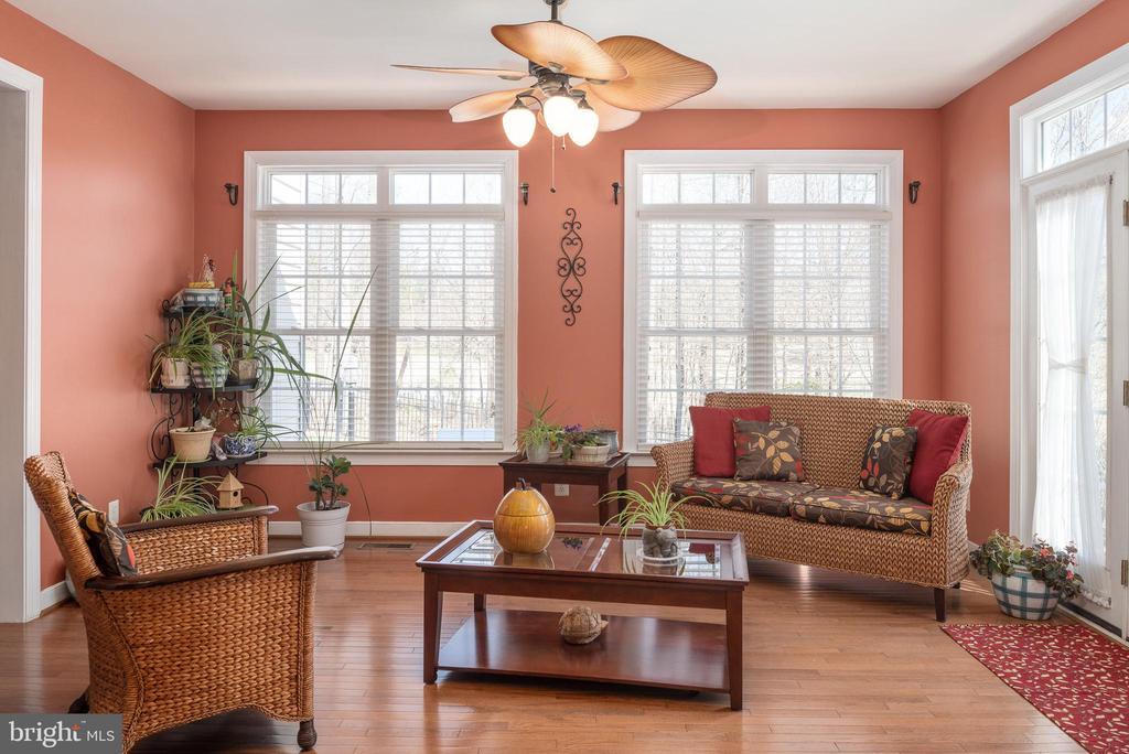 Sunroom wood flrs, ceiling fan & walls of windows - 3 GRISTMILL DR, STAFFORD