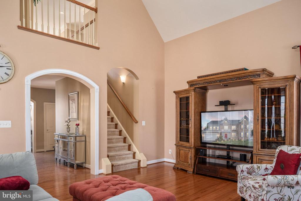 Wood staircase with carpet runner. - 3 GRISTMILL DR, STAFFORD