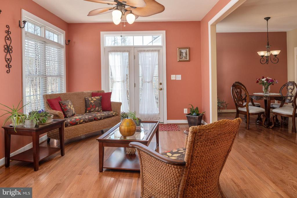 Sunroom with French door leading to backyard patio - 3 GRISTMILL DR, STAFFORD