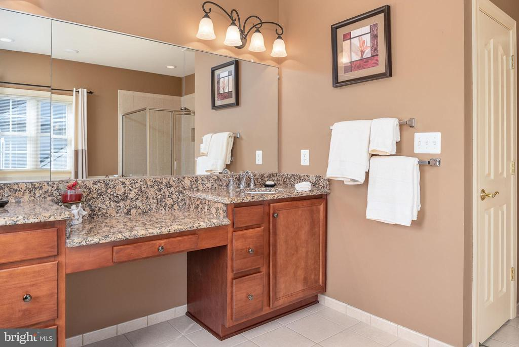 Wall of mirrors, space for chair at the vanity. - 3 GRISTMILL DR, STAFFORD