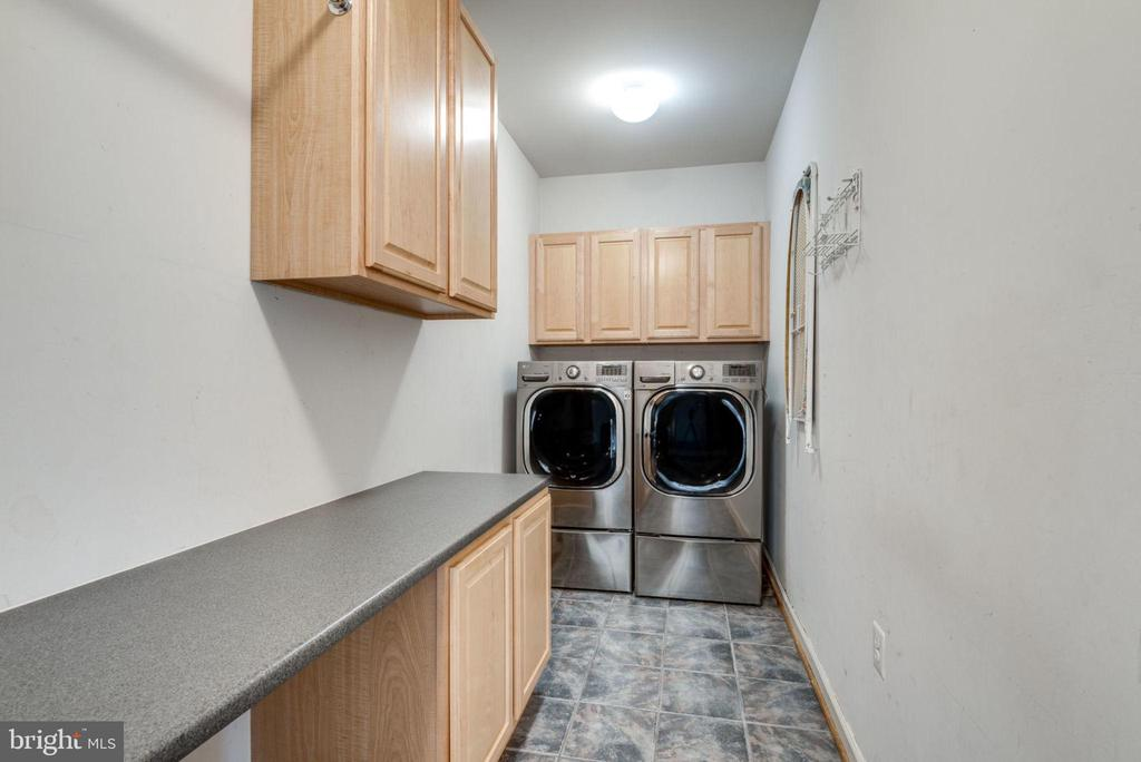 Laundry room with shelving and counter space - 603 BEAUREGARD DR SE, LEESBURG
