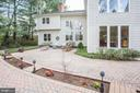 Paver patio with a river of flowers - 8201 SPRING HILL LN, MCLEAN