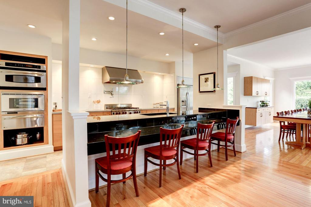 A chef's dream kitchen with expansive table space - 8201 SPRING HILL LN, MCLEAN