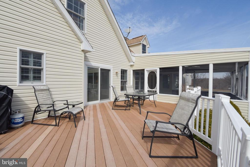 Large trex deck connected to the master suite - 7960 TALBOT RUN RD, MOUNT AIRY