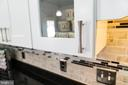 Glass front cabinets with modern nickel handles - 7960 TALBOT RUN RD, MOUNT AIRY