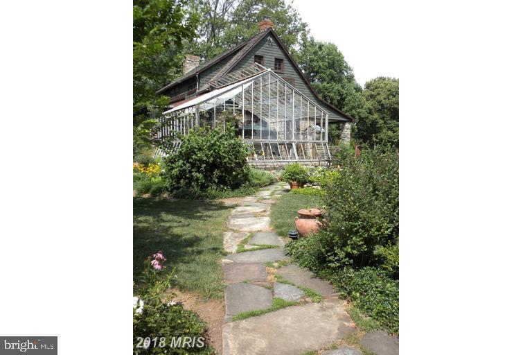 Beautiful landscaping lines the stone walkway - 13410 GOODHART LN, LEESBURG