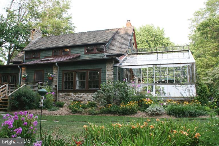 Check out this vintage greenhouse addition - 13410 GOODHART LN, LEESBURG