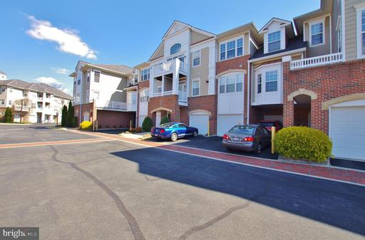 7860 ROLLING WOODS CT #104