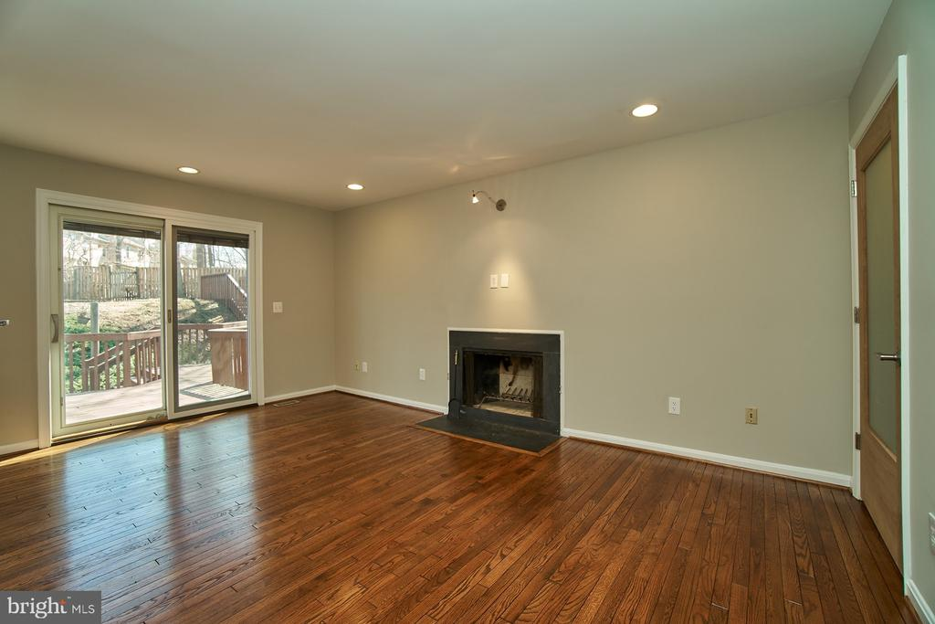 Family room with wood-burning fireplace - 8588 CORAL GABLES LN, VIENNA