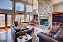 Dramatic stone fireplace and high arched windows - 14720 SUMMIT VIEW, PURCELLVILLE