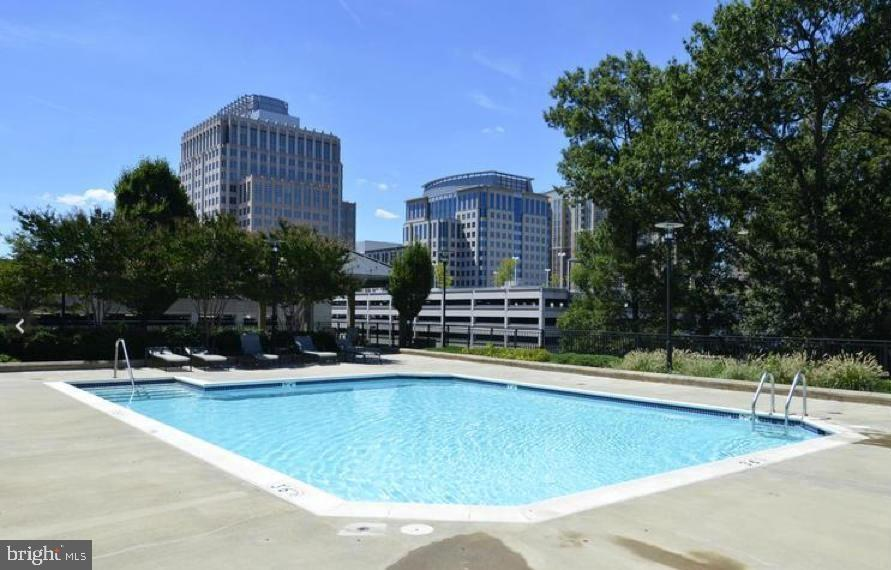Outdoor community pool - 1830 FOUNTAIN DR #1001, RESTON