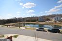 View from back bedrooms of community pond - 1320 RIBBON LIMESTONE TER SE, LEESBURG
