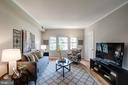 Living Room with Wall of Windows! - 1735 N TROY ST #8-415, ARLINGTON