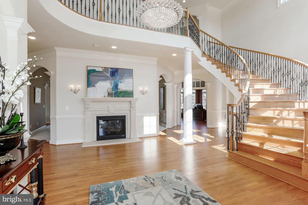 Foyer with Curved Oak Staircase - 40471 GRENATA PRESERVE PL, LEESBURG