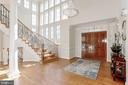 Two Story Foyer with Crystal Chandelier - 40471 GRENATA PRESERVE PL, LEESBURG